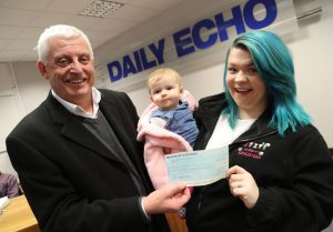 Daily Echo editor Andy Martin presents a cheque for £3900 from the Gannett Foundation to Ashley's Birthday Bank received by Danielle Turner and Beatrix, 5 months.